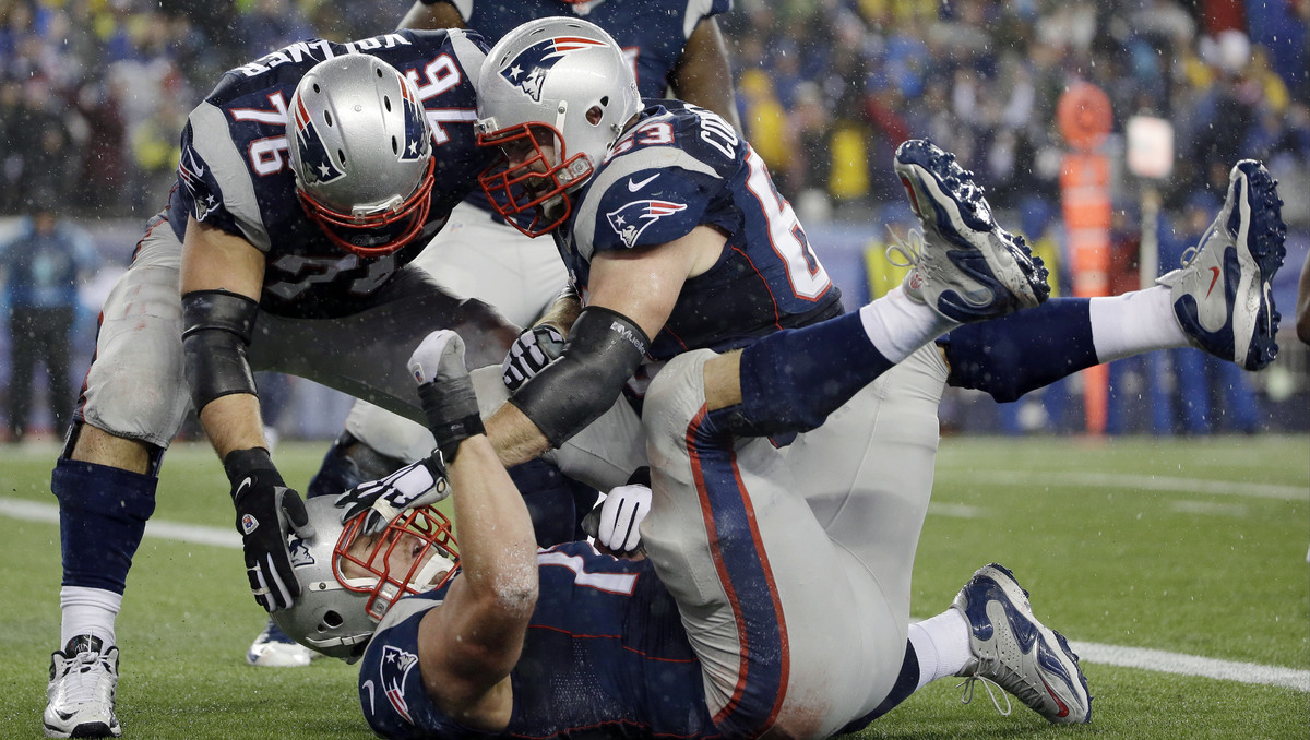 New England Patriots tackle Nate Solder, below, is congratulated by his teammates after scoring on a 16-yard touchdown pass d