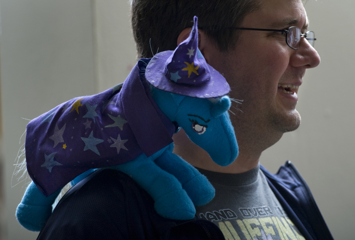 WASHINGTON, DC - MARCH 31:  Bronies member Andrew Singley, 32, chats with friends with 'Trixie' on his shoulder at a monthly