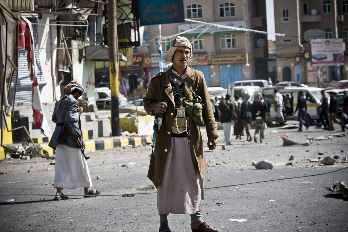 Houthi Yemenis guard a street leading to the presidential palace in Sanaa, Yemen, Jan. 20, 2015.
