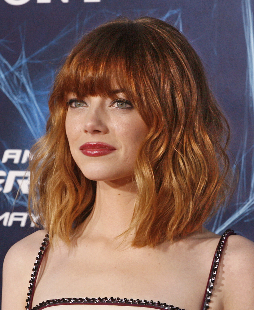 37 emma stone hairstyles to inspire your next makeover huffpost getty images urmus Choice Image