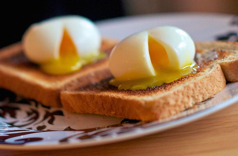 """A soft boiled egg is cooked by placing the egg, still in its shell, in a pot of boiling water <a href=""""http://www.seriouseats"""