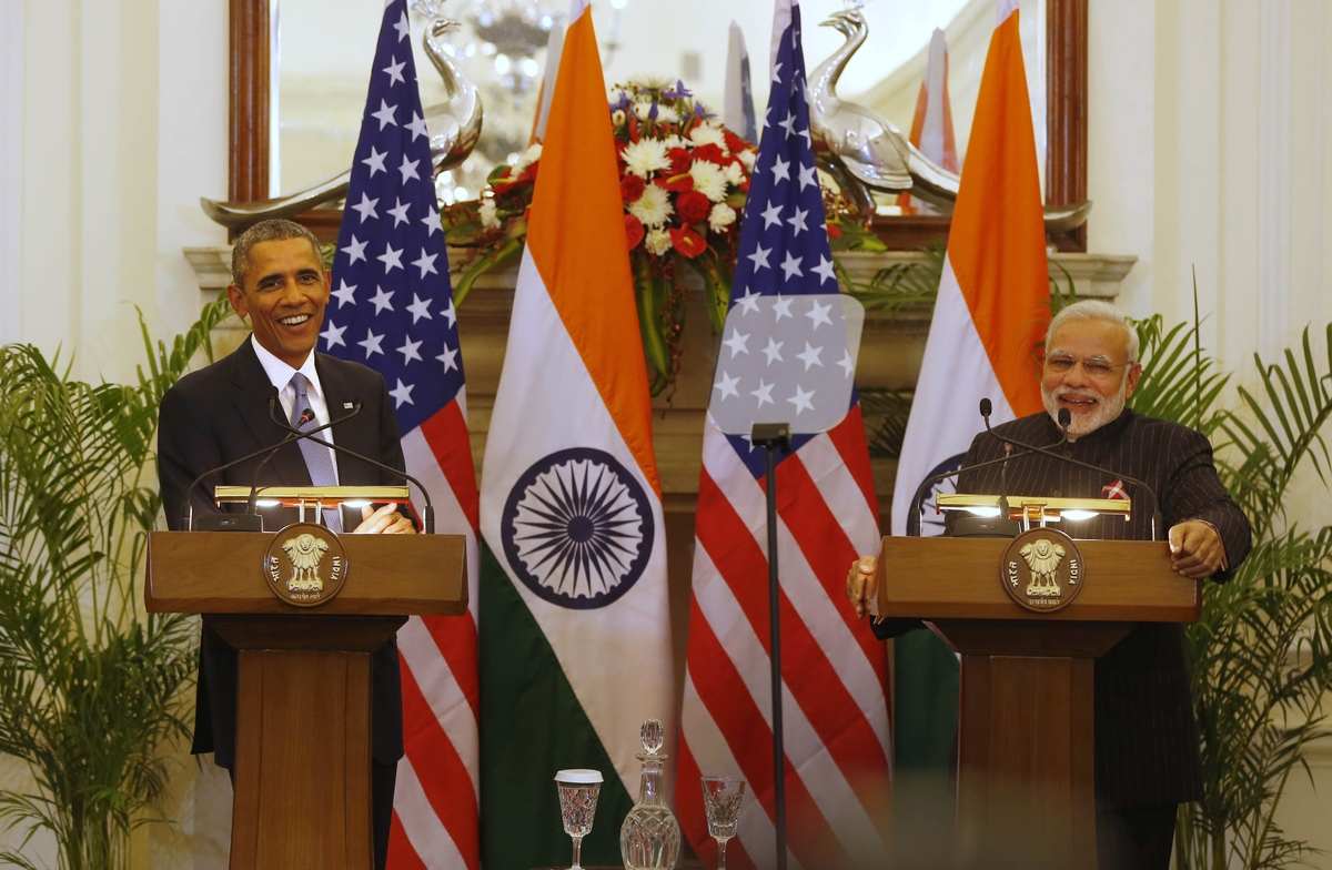 U.S. President Barack Obama, left and Indian Prime Minister Narendra Modi jointly address the media after their talks, in New