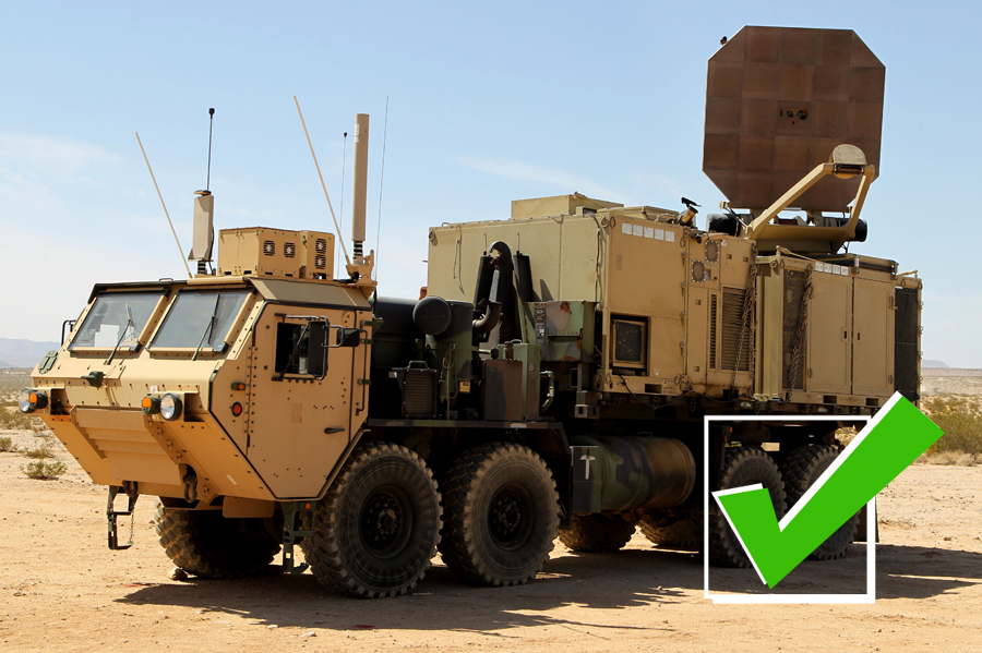 This is the US Military's Active Denial System, or ADS. It's a truck-mounted high-powered microwave weapon that when directed