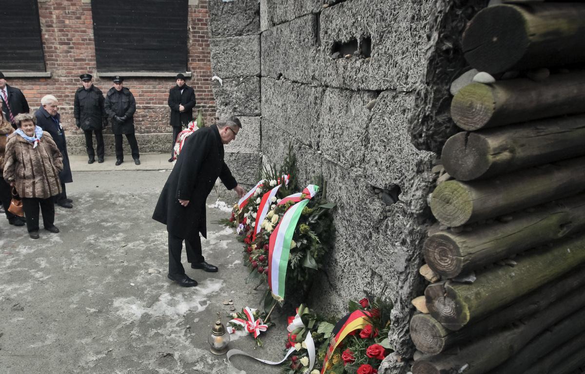 Polish President Bronislaw Komorowski lays a wreath at the Executions Wall, or Wall of Death, of the Auschwitz Nazi death cam