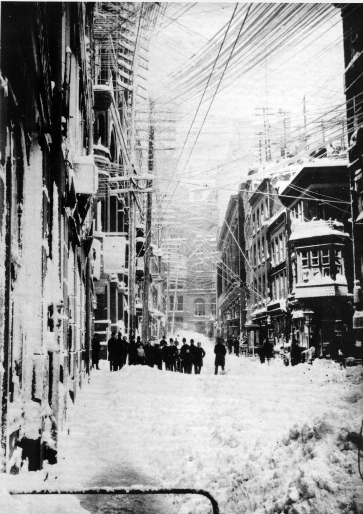 "A New York street is shown during the blizzard of 1888.  The blizzard that occured March 12-14 paralyzed the city with 40"" of"