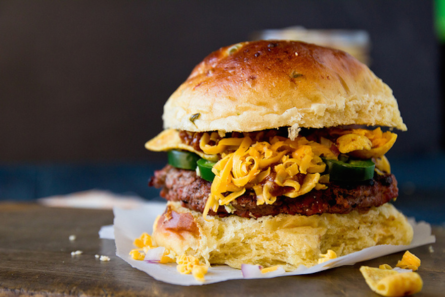 """<strong>Get the <a href=""""http://www.jasonandshawnda.com/foodiebride/archives/11505"""" target=""""_blank"""">Frito Pie Burger recipe</"""
