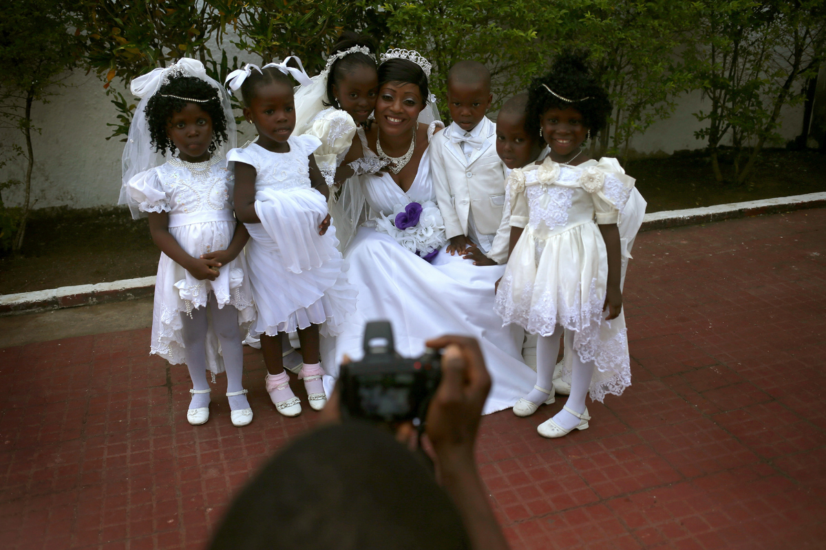 Bindu Quaye poses for photos with flower girls before her wedding reception on Jan. 24, 2015 in Monrovia, Liberia. Like many