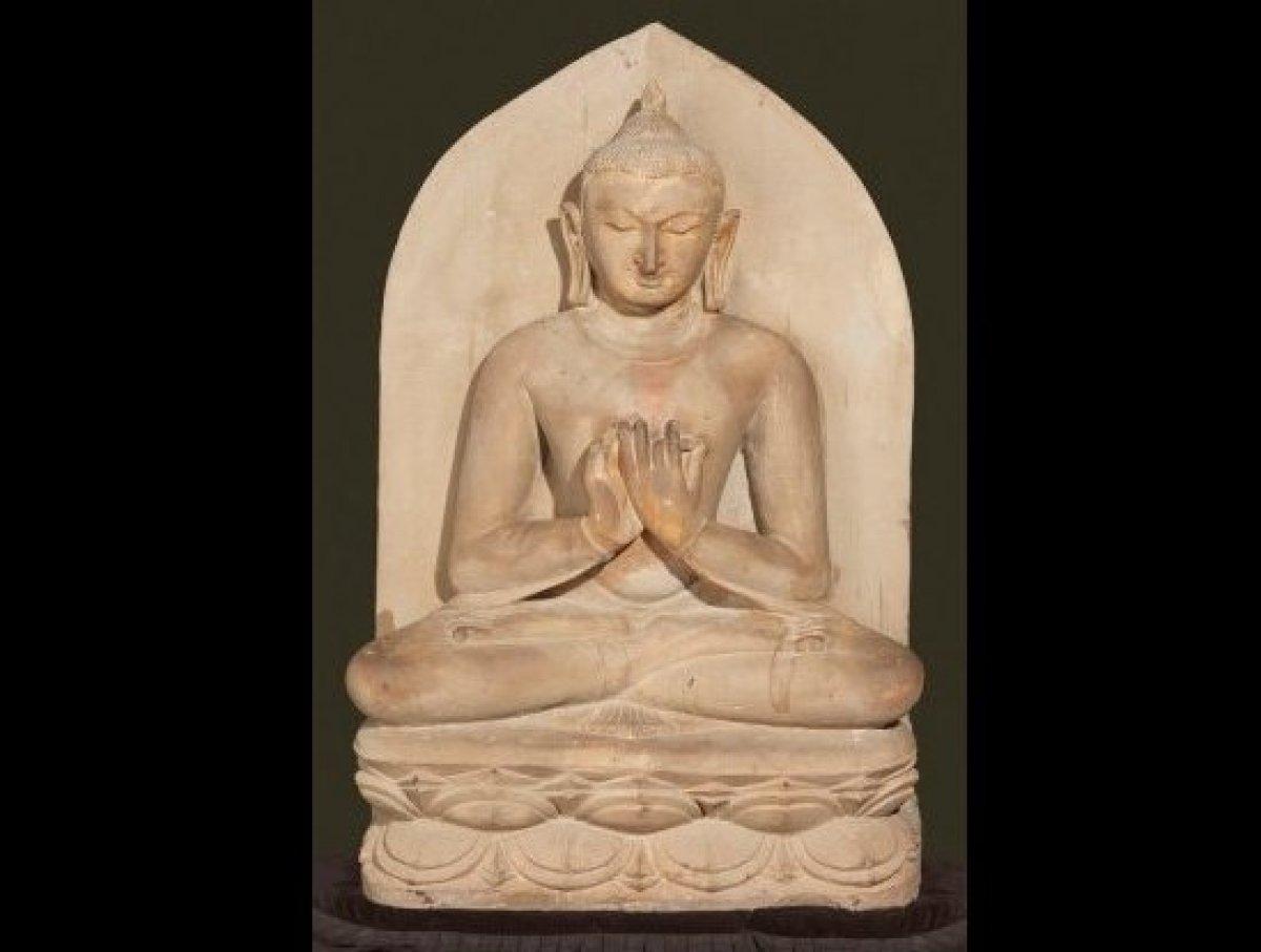 Buddha seated in dharmacakra mudra; Pagan period, 11th century; Sandstone; H. 42 x W. 27 x D. 10 in. (106.7 x 68.6 x 25.4 cm)