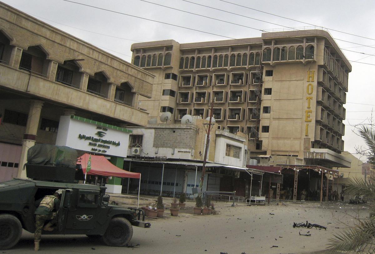 Kurdish peshmerga fighters secure a hotel near police headquarters in oil-rich Kirkuk, 290 kilometers (180 miles) north of Ba