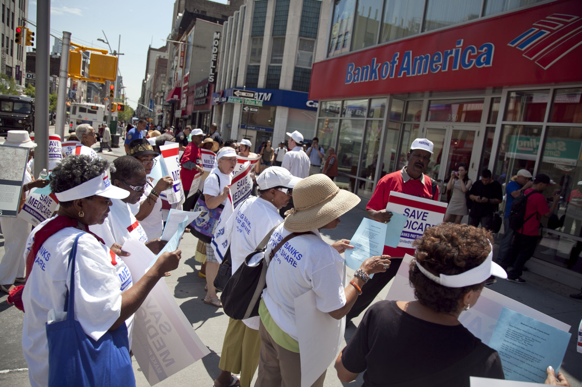 Outraged senior citizens stage a protest at the Bank of America asking for big banks to pay their share in order to save Medi