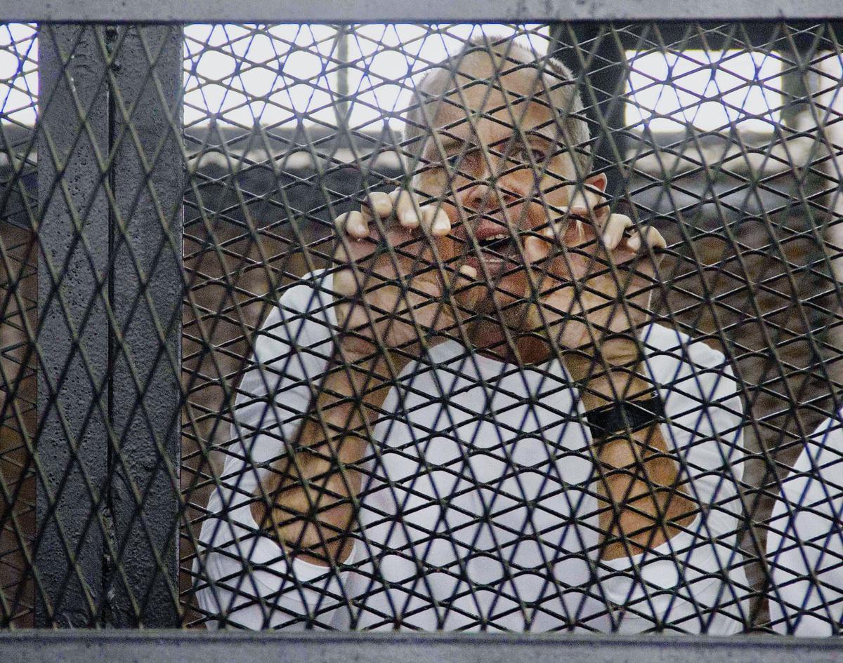 FILE - In this Saturday, May 3, 2014 file photo, Al-Jazeera's award-winning Australian correspondent Peter Greste, appears in