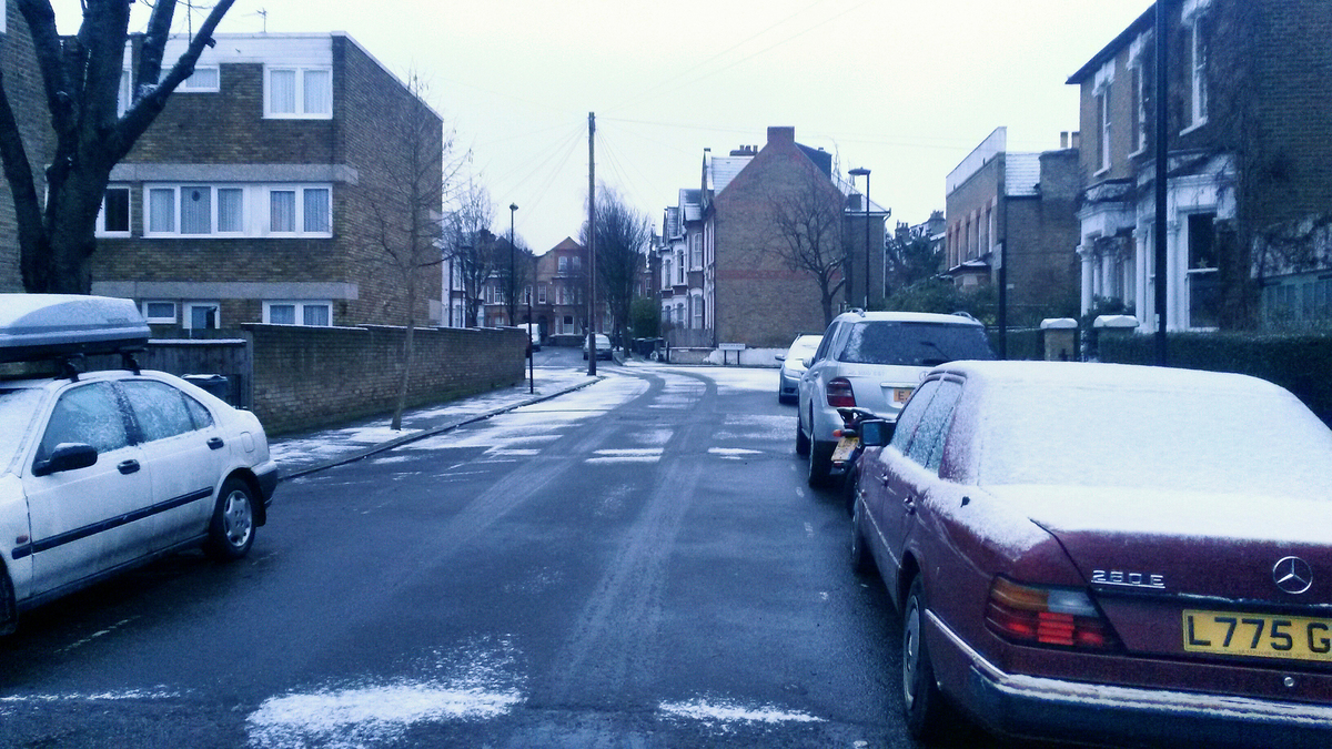 Serious UK snow on cars in Brixton.