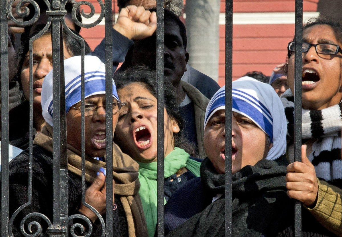 Indian Christians shout slogans protesting against recent attacks on churches in the Indian capital as they assemble outside