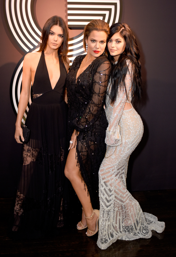 HOLLYWOOD, CA - FEBRUARY 08:  (L-R) TV personalities Kendall Jenner, Khloe Kardashian, and Kylie Jenner attend GQ and Giorgio