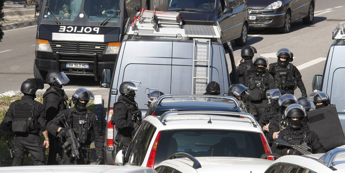 Elite police officers gather outside the Castellane housing project of Marseille, southern France, Monday, Feb.9, 2015.  (AP