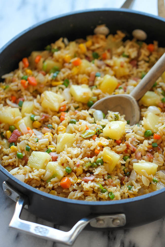 """<strong>Get the <a href=""""http://damndelicious.net/2014/06/25/pineapple-fried-rice/"""" target=""""_blank"""">Pineapple Fried Rice reci"""
