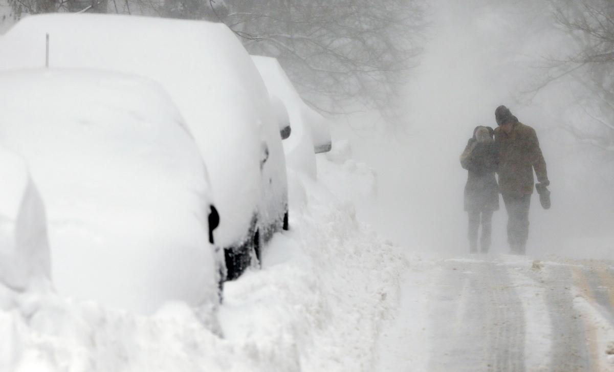 Graham Jamison, right, and Austin Anschultz walk through blowing snow on Beacon Hill in Boston, Sunday, Feb. 15, 2015. A bliz