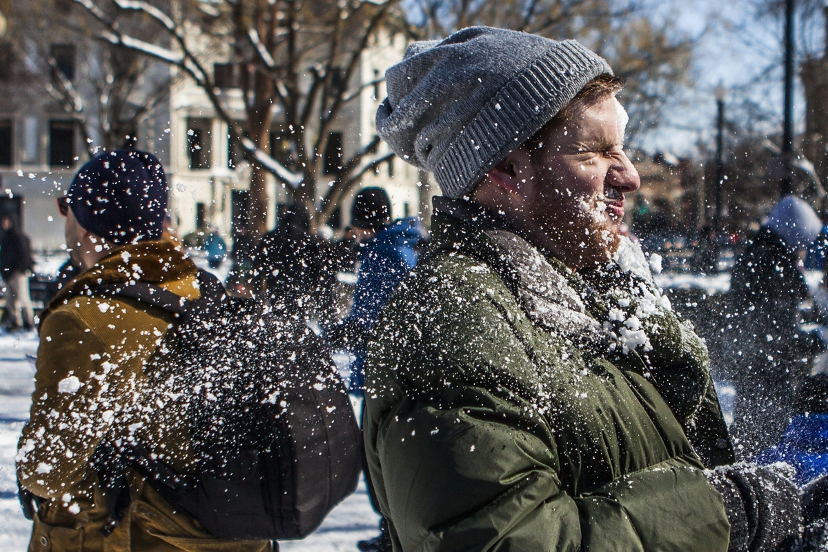 Jerry Rogers, 23 from Perry, Ga., gets hit in the face by a snowball as hundreds of people gather for a massive snowball figh