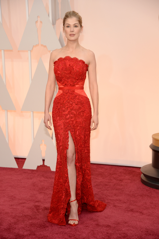 """One word: Showstopper. We literally fell out of our seats when the """"Gone Girl"""" actress stepped onto the red carpet in this ra"""