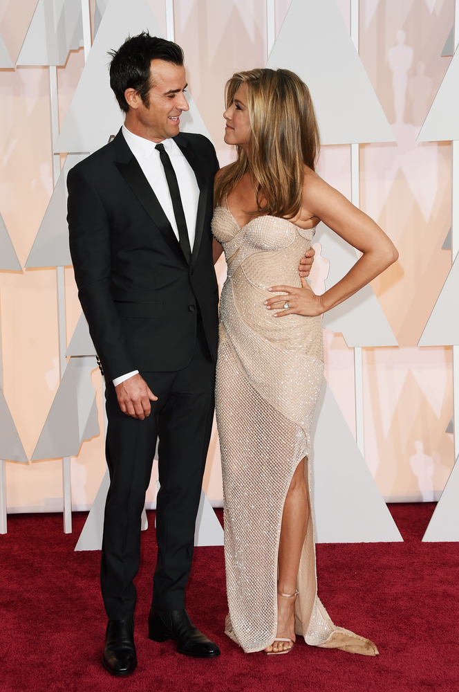 HOLLYWOOD, CA - FEBRUARY 22:  Actors Justin Theroux (L) and Jennifer Aniston attend the 87th Annual Academy Awards at Hollywo