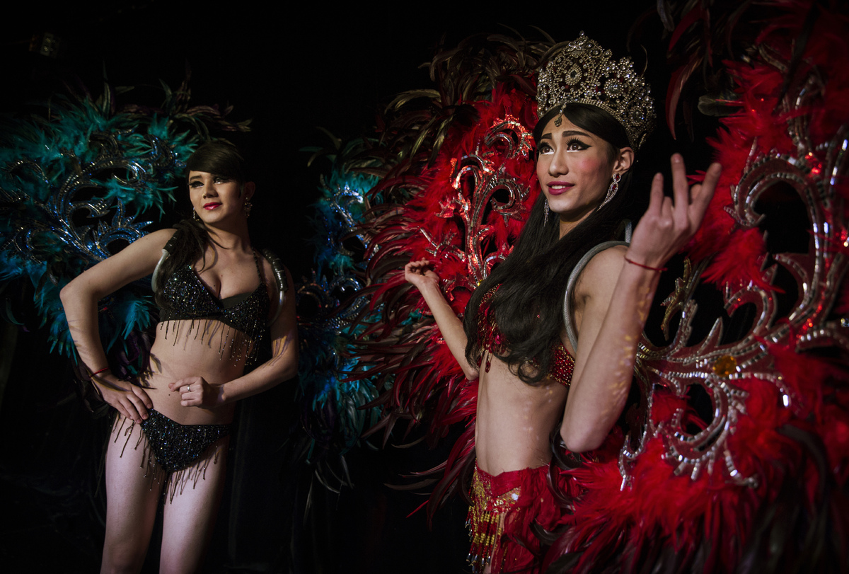 Chinese drag queens Baomei, right, and Xiaoyi, left, on stage at the Chunai 98 club on January 11, 2015 in Nanning, Guangxi P
