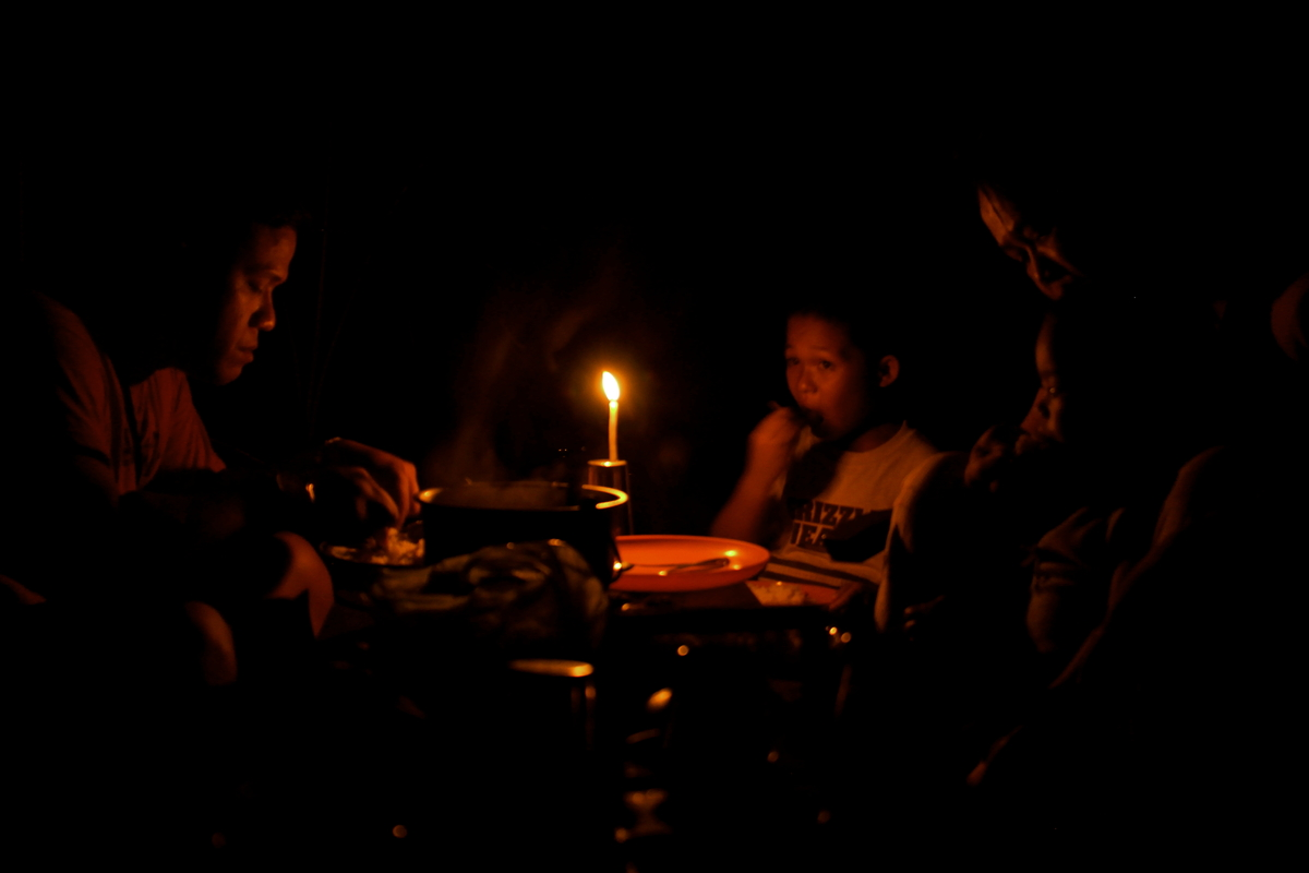 """For their choice of """"second winner,"""" Terry and Oliver picked """"Candlelight Supper,"""" an image by Breech Asher Harani. It <a hre"""