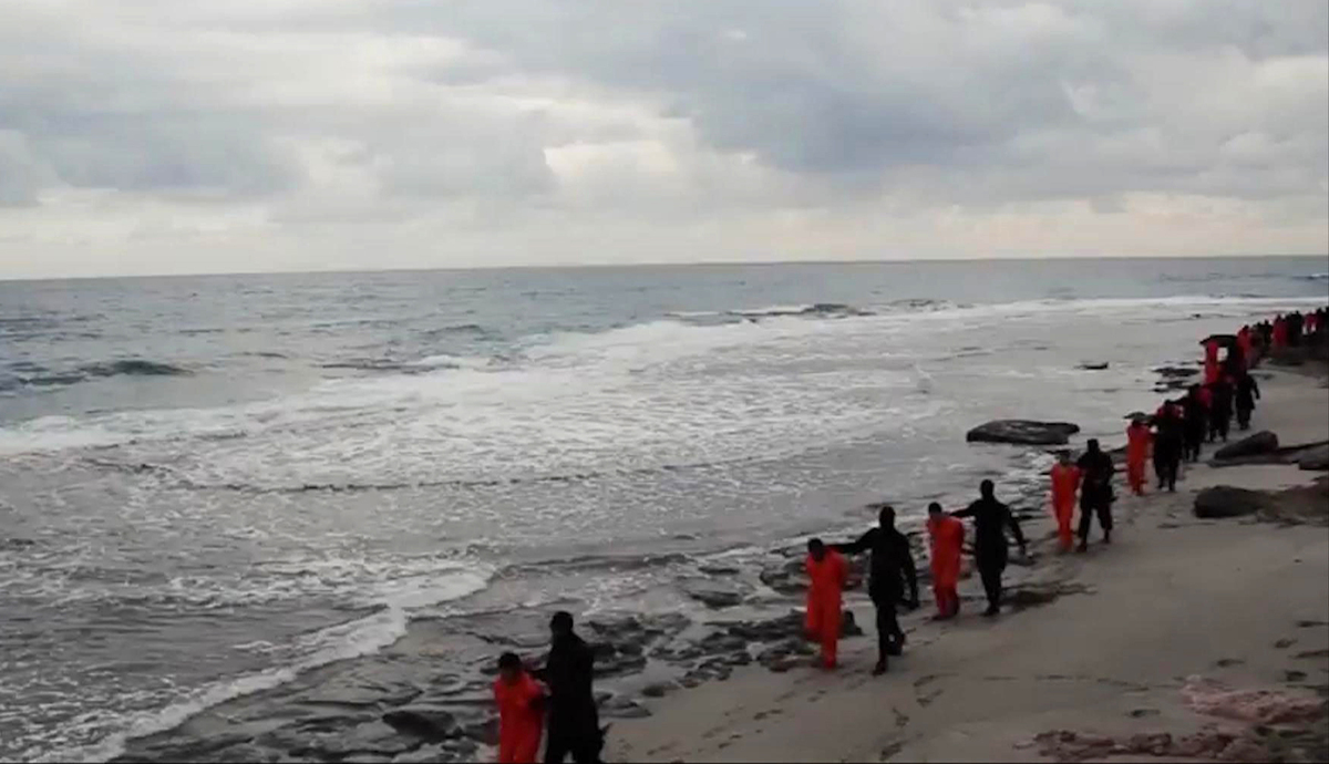 In this file image made from a video released Sunday, Feb. 15, 2015 by militants in Libya claiming loyalty to the Islamic Sta