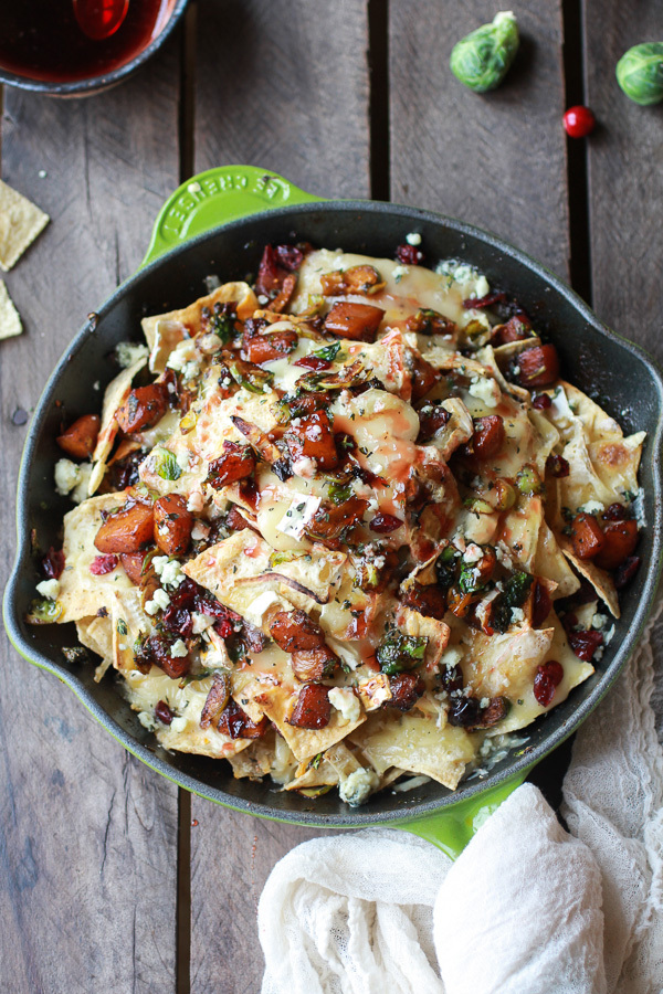 "<strong>Get the <a href=""http://www.halfbakedharvest.com/cranberry-butternut-brussels-sprout-brie-skillet-nachos/"" target=""_b"