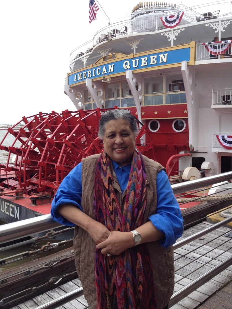 """Pat standing in  front of the American Queen Steamboat """"big red"""" paddlewheel!"""
