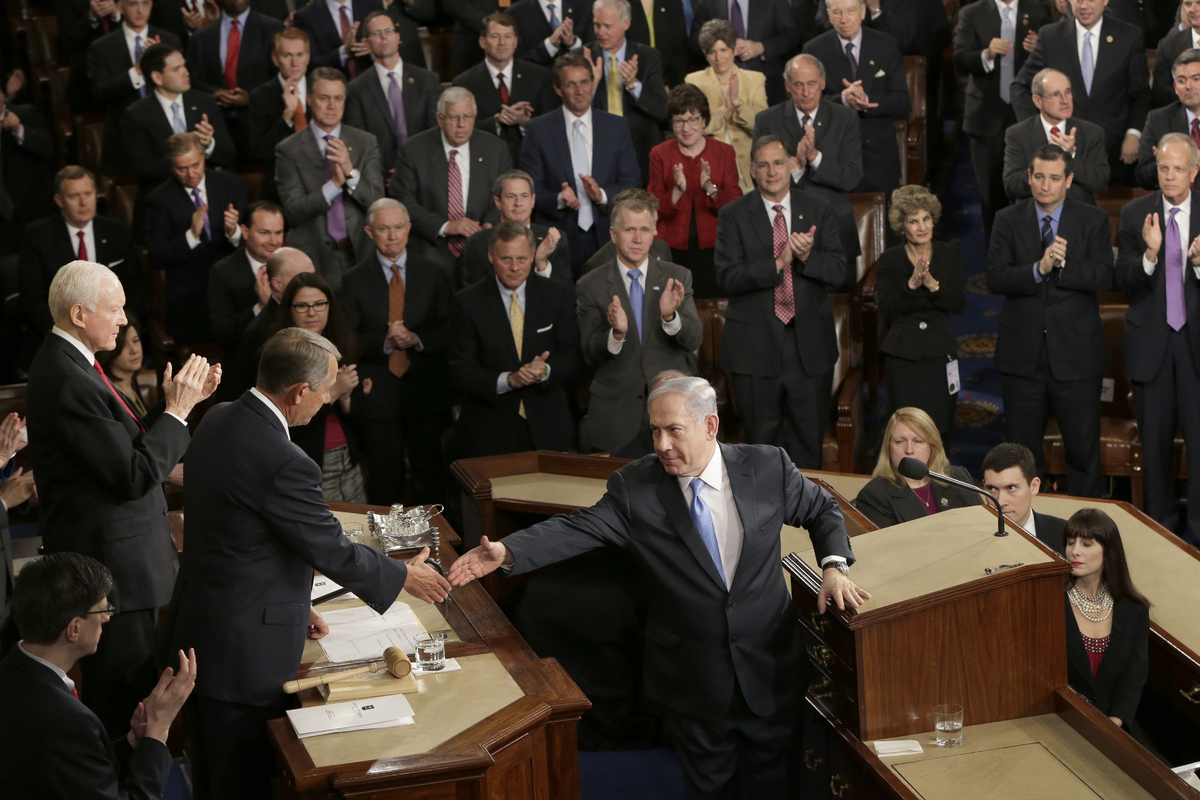 Israeli Prime Minister Benjamin Netanyahu reaches to shake hands with House Speaker John Boehner of Ohio after addressing a j