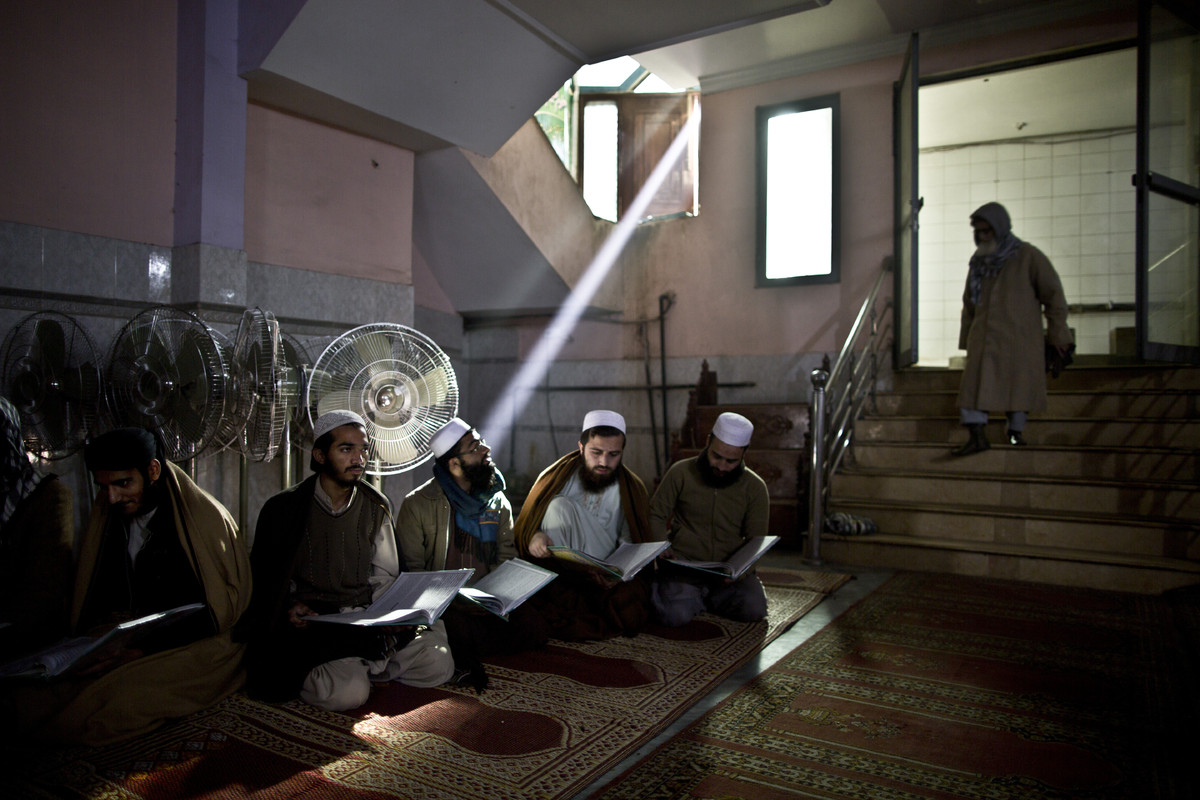 In this Sunday, Jan. 18, 2015 photo, Pakistani students of a madrassa, or Islamic school, attend their class at a seminary in