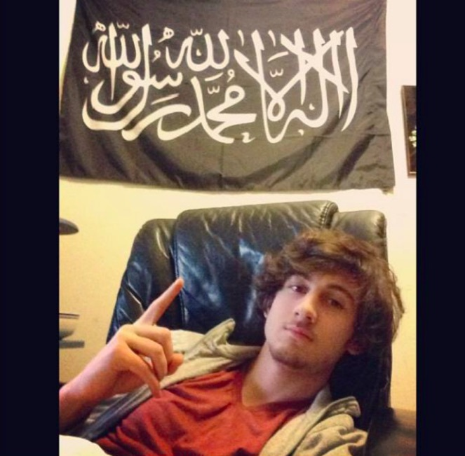 Prosecutors presented this image of Dzhokhar Tsarnaev in his Cambridge, Massachusetts bedroom beneath a flag often used by Is
