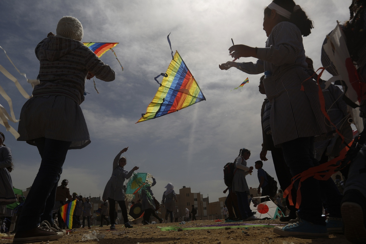 Palestinian school children fly kites to show solidarity with Japan, near a Japanese-funded housing project in Khan Younis in
