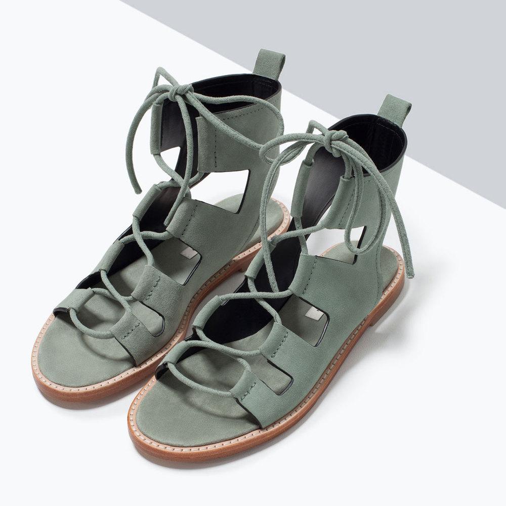 "<a href=""http://www.zara.com/us/en/shoes---bags/woman/shoes/leather-roman-sandal-c598019p2474595.html"" target=""_blank"">Zara """