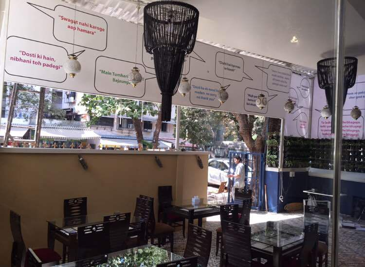The exterior seating area of the restaurant features memorable lines of dialogue from Salman Khan's movies. Examples include