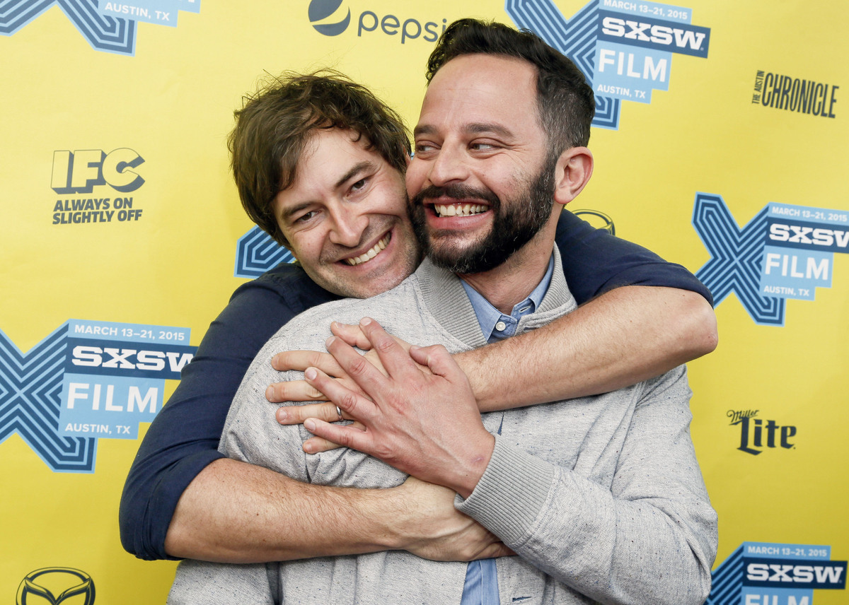 "Mark Duplass, left, and Nick Kroll horse around on the red carpet for ""Adult Biginners"" during the South by Southwest Film Fe"