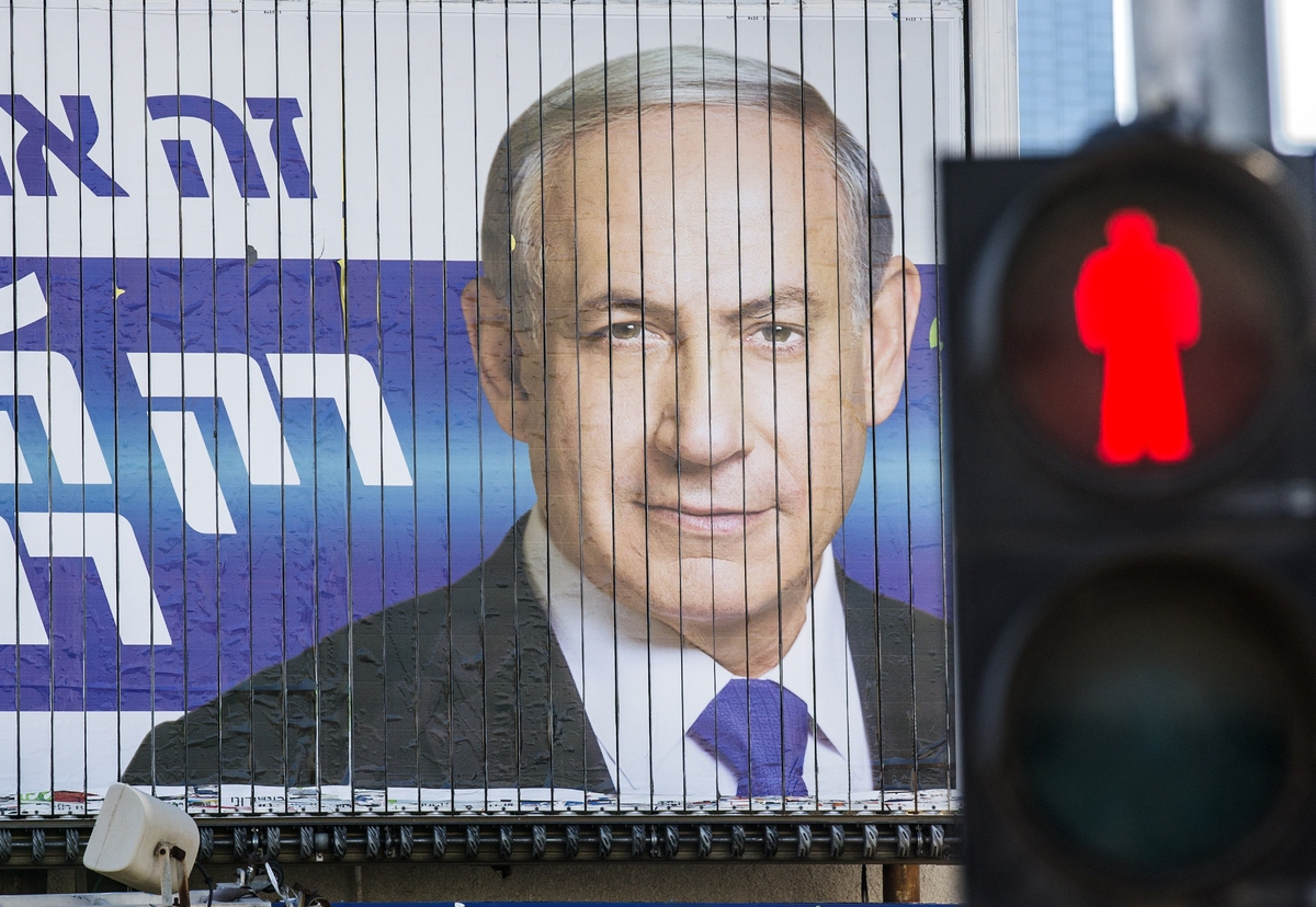 A giant campaign billboard rotates showing Israeli Prime Minister and Likud party's candidate running for general elections,