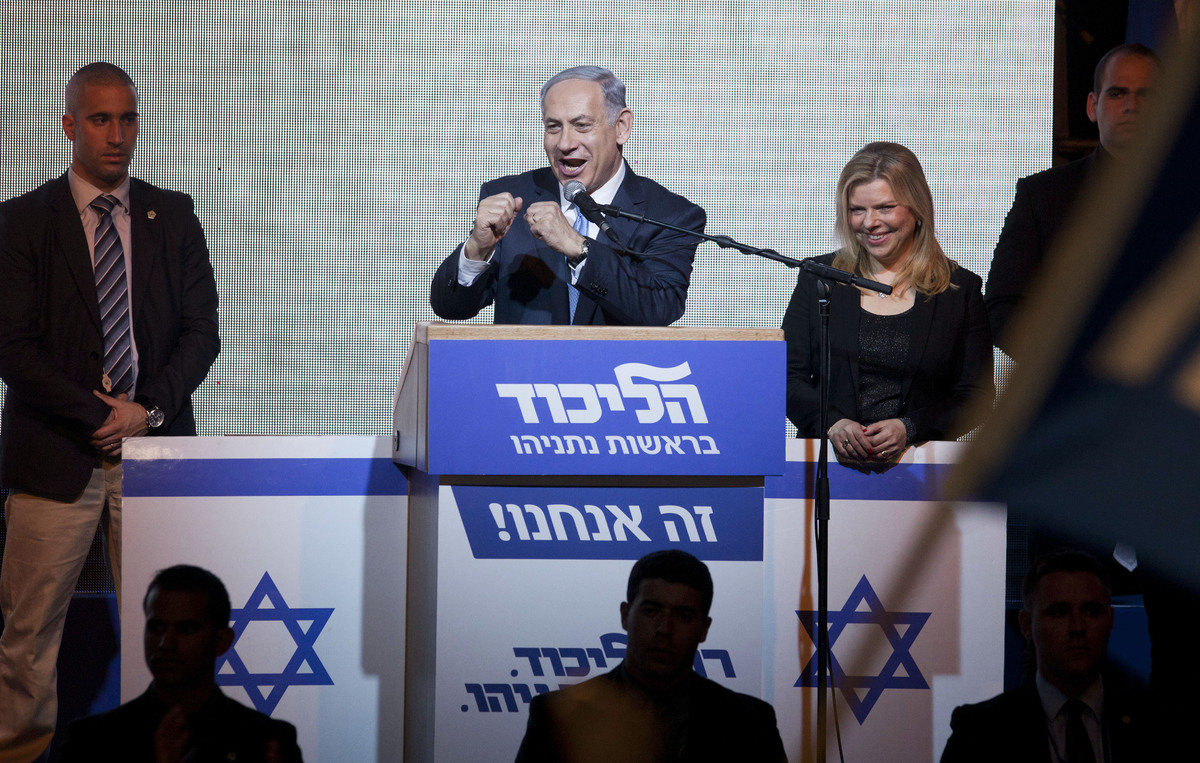 Israeli Prime Minister Benjamin Netanyahu greets supporters at the party's election headquarters In Tel Aviv. Wednesday, Marc