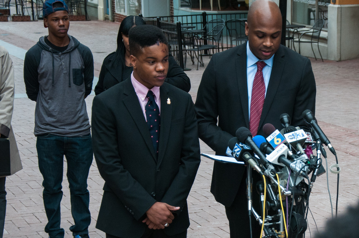 Martese Johnson's lawyer reading a statement to the gathered media on Charlottesville's downtown mall.