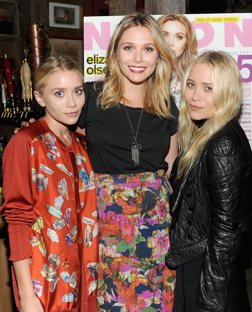 Twins Mary-Kate and Ashley Olsen with their younger sister, Elizabeth.