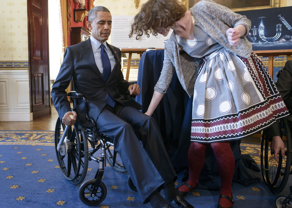 President Barack Obama tries a wheelchair powered by a rowing motion designed by Kaitlin Reed of Massachusetts during the 201