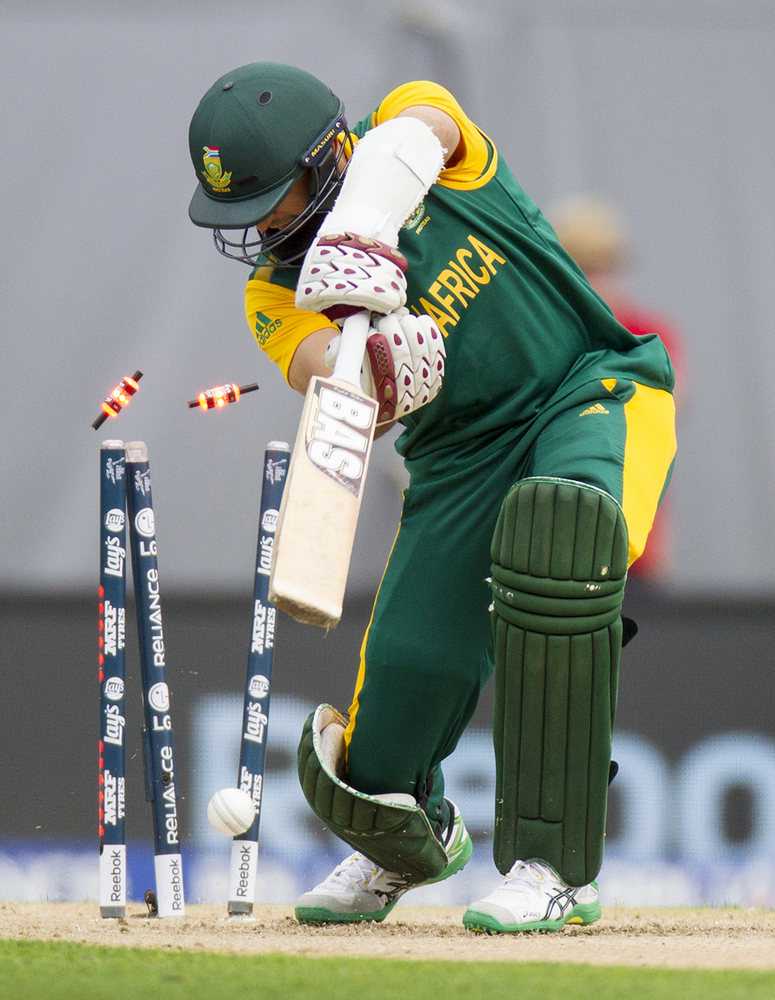 South Africa's Hashim Amla is bowled by New Zealand's Trent Boult for 10 runs during their Cricket World Cup semifinal in Auc