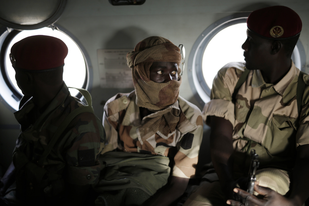 Chadian soldiers returning from the Nigerian city of Damasak, Nigeria, sit in a helicopter Wednesday March 18, 2015. (AP Phot