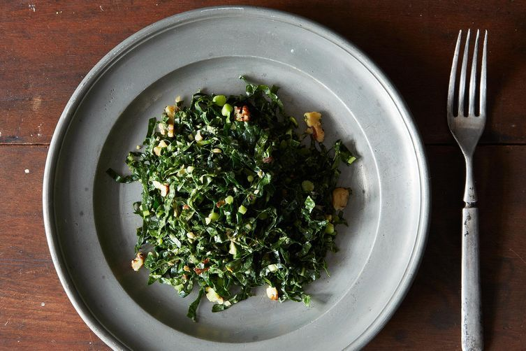 "<strong>Get the <a href=""http://food52.com/recipes/18080-lacinato-kale-and-mint-salad-with-spicy-peanut-dressing"" target=""_bl"