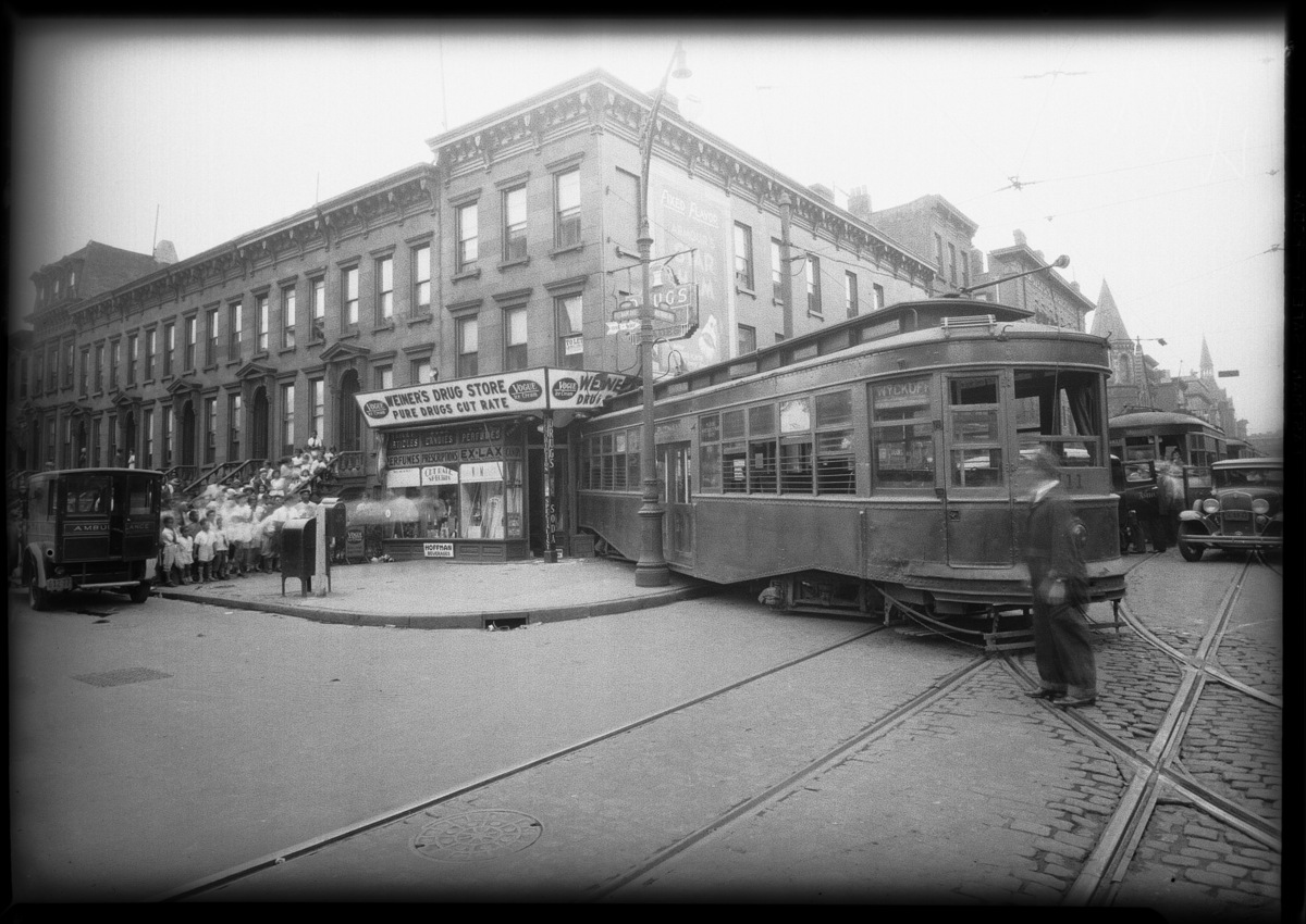 A streetcar jumped the tracks and crashed into a store on the intersection of Nostrand and Putnam Avenues in July of 1931.