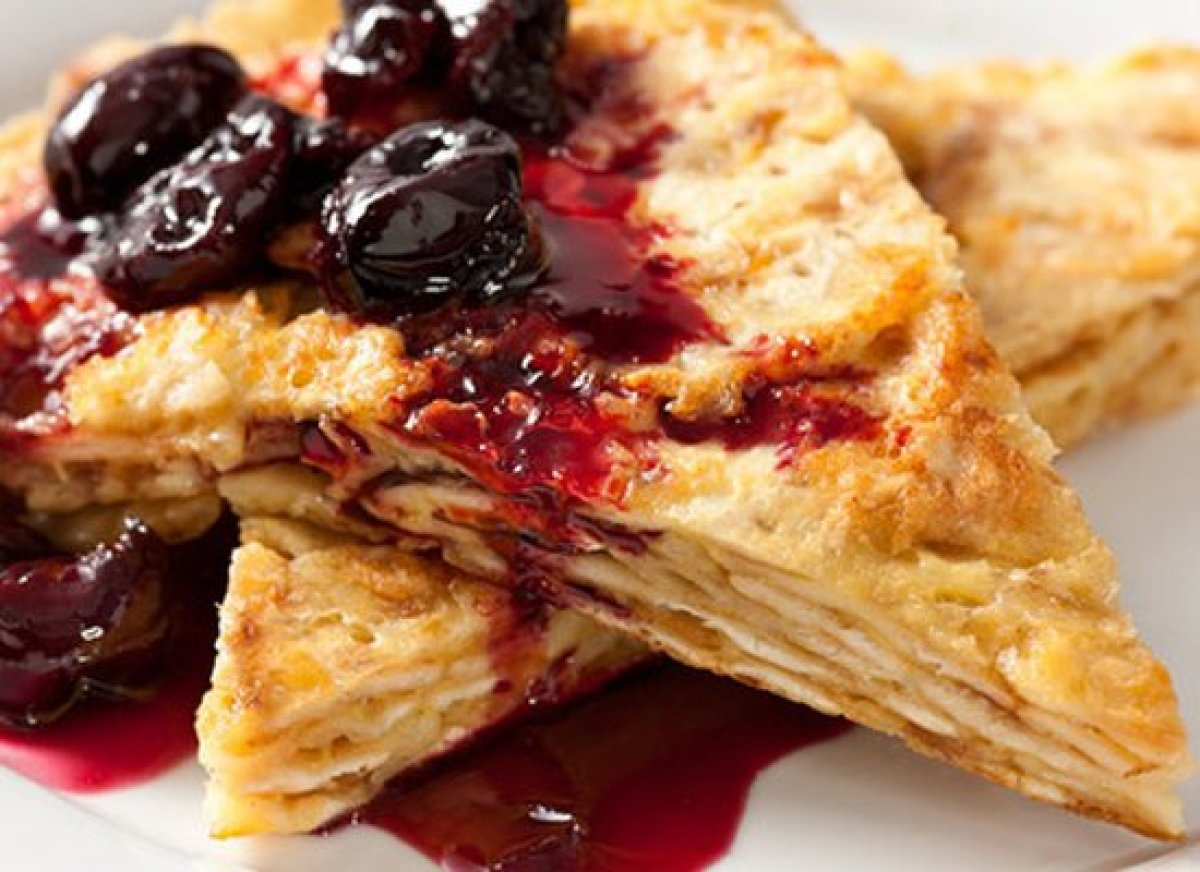 """<strong>Get the <a href=""""http://www.chow.com/recipes/30311-matzo-brei-with-roasted-cherries"""" target=""""_hplink"""">Matzo Brei With"""