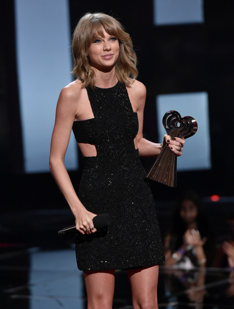 "Taylor Swift accepts the award for song of the year for ""Shake It Off"" at the iHeartRadio Music Awards at The Shrine Audi"