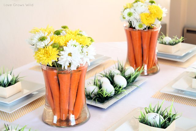"""Create an elegant floral display using carrots and a leftover bouquet. Get a closer look at <a href=""""http://lovegrowswild.com"""