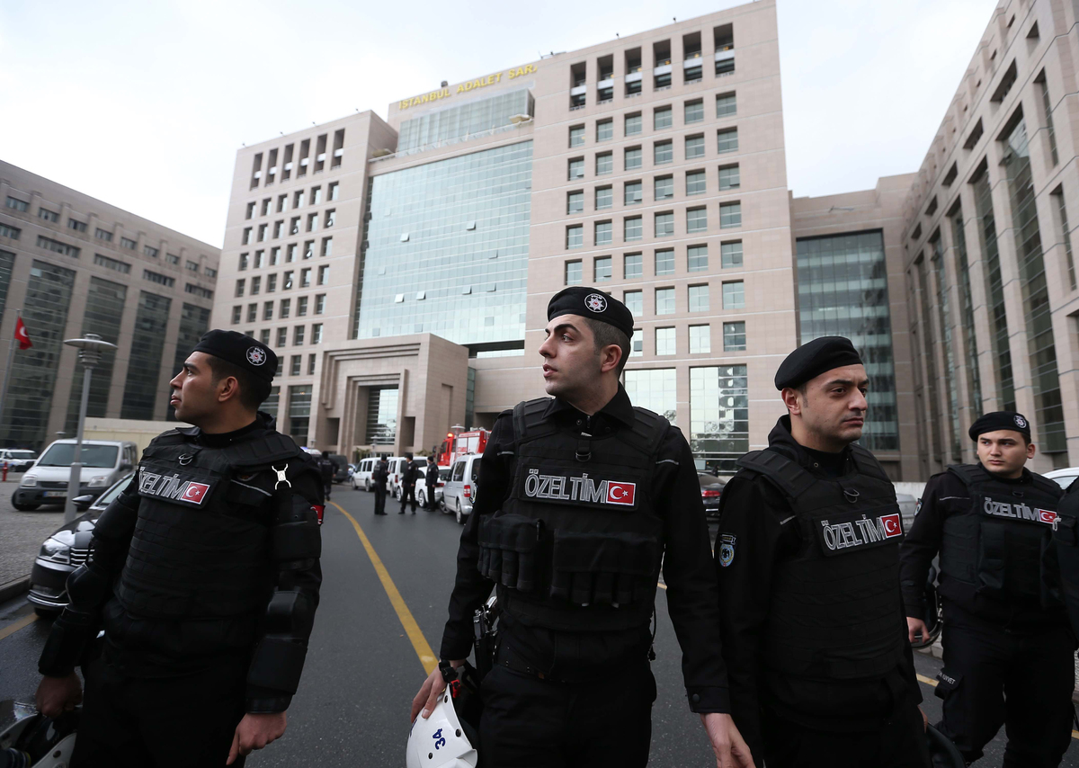Members of special security forces stand outside the main courthouse in Istanbul, Turkey, Tuesday, March 31, 2015. (AP Photo/