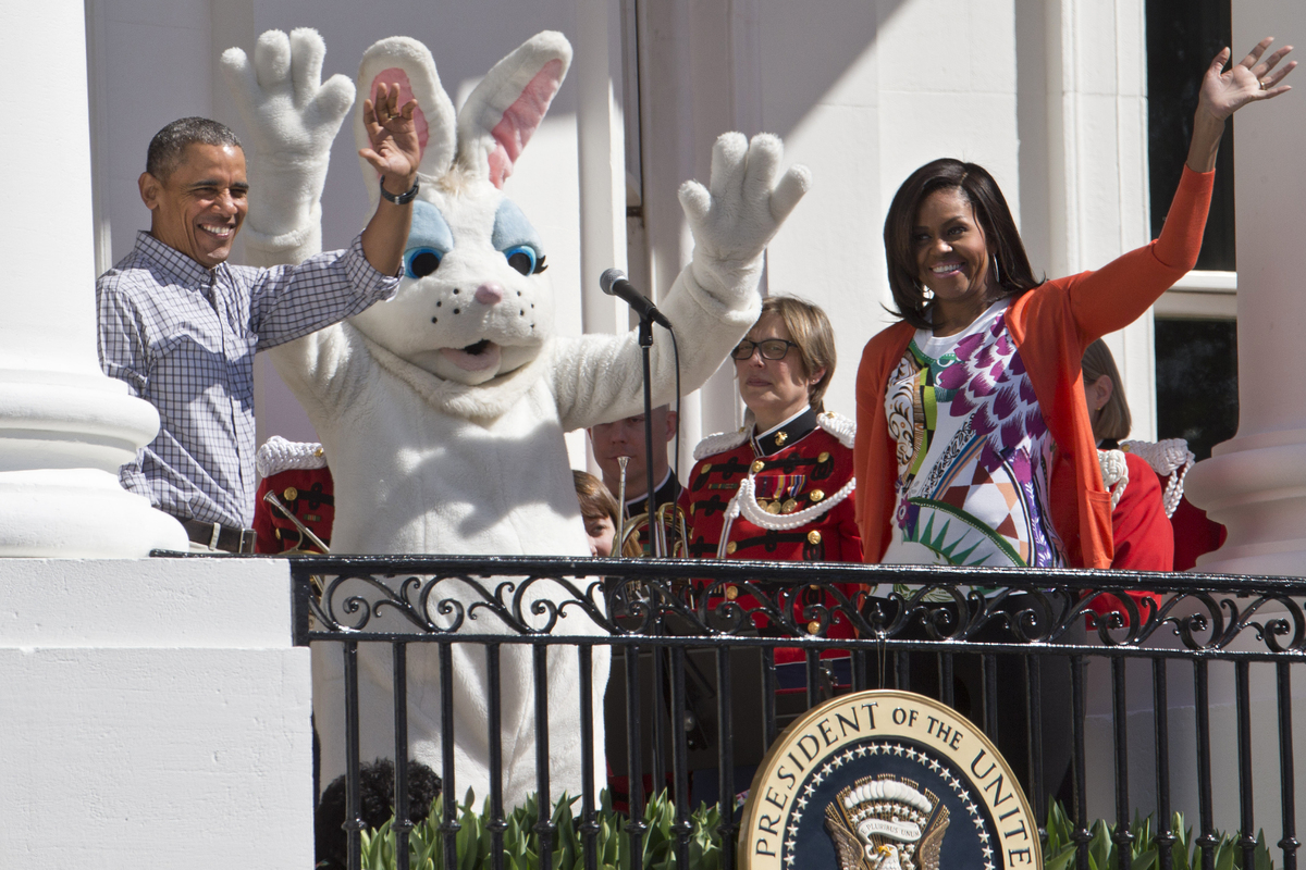 President Barack Obama and first lady Michelle Obama wave with the Easter Bunny as they greet families participating in the W
